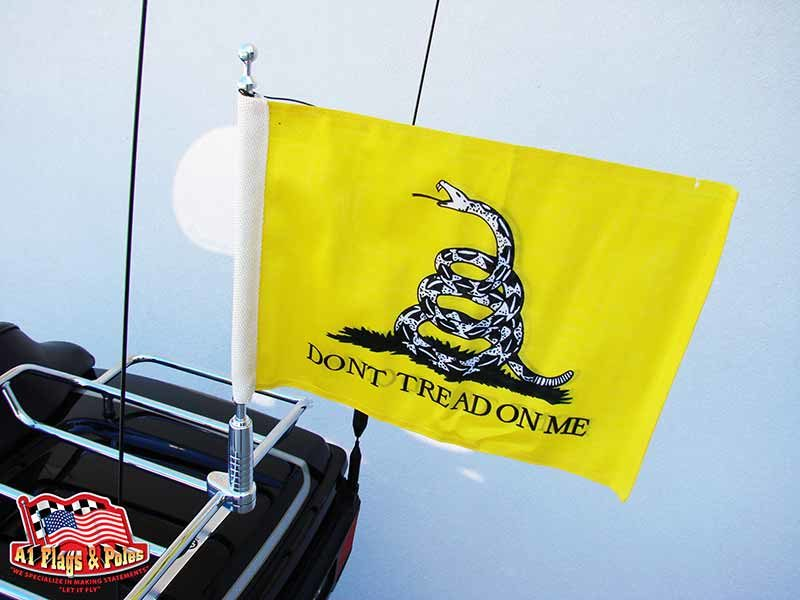 harley davidson motorcycle with 1 motorcycle flagpole with gadsden flag mounted on the luggage rack.