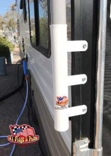 RV toy hauler with ramp flagpole mount up close