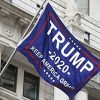 Trump 2020 Keep America Great Flag. Flying on a flagpole mounted on a big building